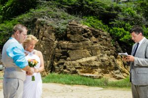 the bride groom and officiant