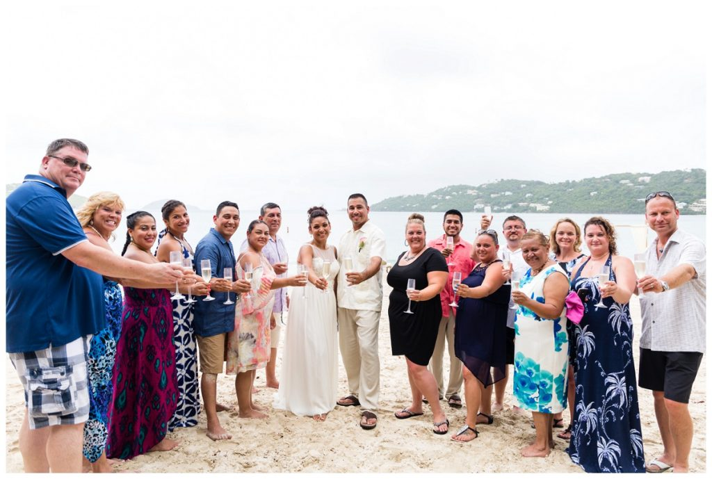 toast to the bride and groom after beach wedding