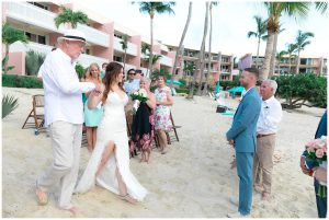 wedding aisle to wedding altar on beach where groom is standing